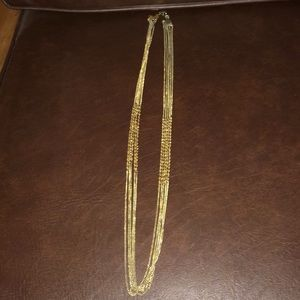 Long gold-colored necklace